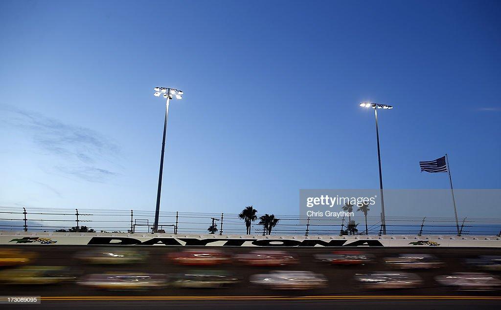 Cars race during the NASCAR Sprint Cup Series Coke Zero 400 at Daytona International Speedway on July 6 2013 in Daytona Beach Florida