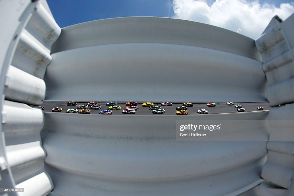 Cars race during the NASCAR Sprint Cup Series Coke Zero 400 at Daytona International Speedway on July 6, 2014 in Daytona Beach, Florida.