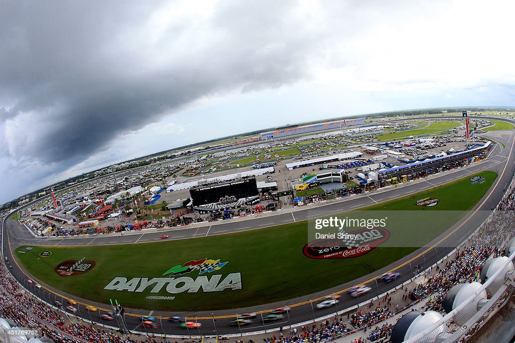 Cars race during the NASCAR Sprint Cup Series Coke Zero 400 at Daytona International Speedway on July 6, 2014 in Daytona Beach, Florida.