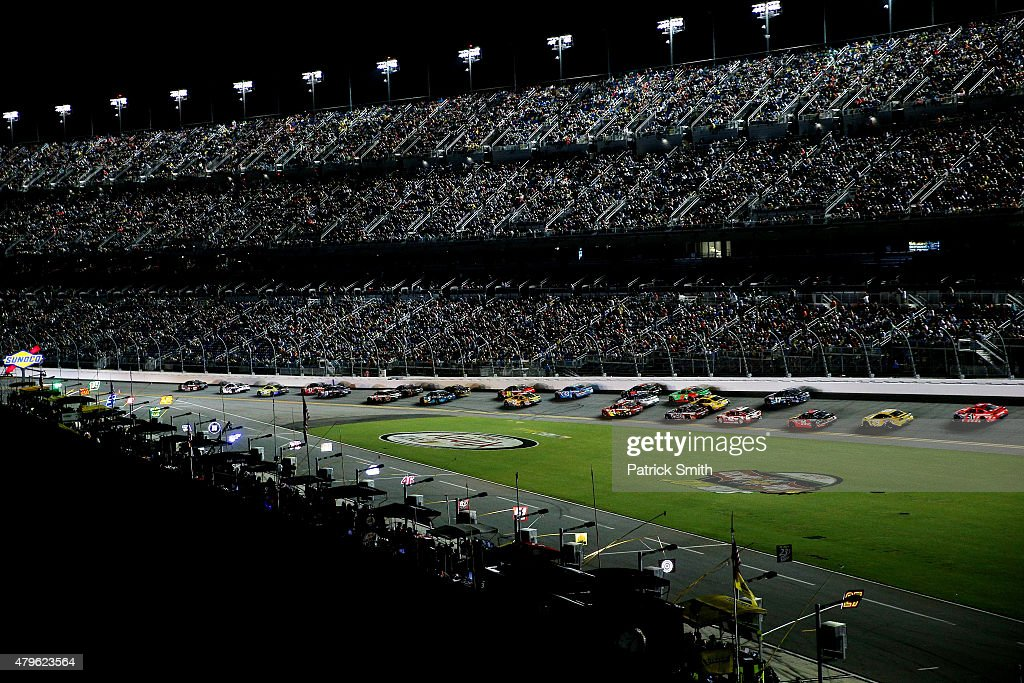 Cars race during the NASCAR Sprint Cup Series Coke Zero 400 Powered by CocaCola at Daytona International Speedway on July 6 2015 in Daytona Beach...