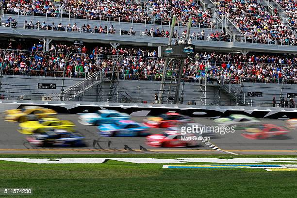 Cars race during the NASCAR Sprint Cup Series DAYTONA 500 at Daytona International Speedway on February 21 2016 in Daytona Beach Florida