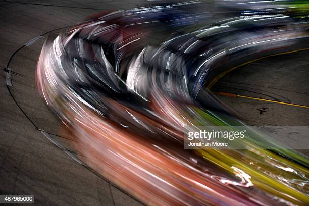 Cars race during the NASCAR Sprint Cup Series Federated Auto Parts 400 at Richmond International Raceway on September 12 2015 in Richmond Virginia