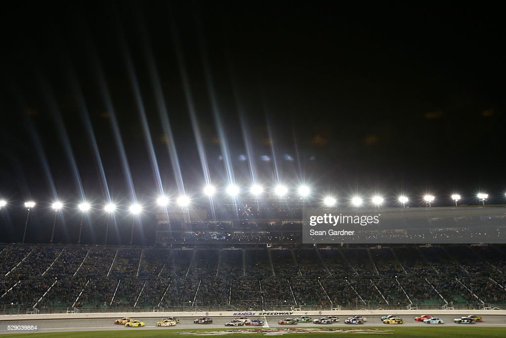 Cars race during the NASCAR Sprint Cup Series Go Bowling 400 at Kansas Speedway on May 7, 2016 in Kansas City, Kansas.
