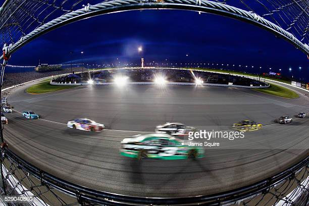 Cars race during the NASCAR Sprint Cup Series Go Bowling 400 at Kansas Speedway on May 7 2016 in Kansas City Kansas