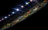 Cars race during the NASCAR Sprint Cup Series Irwin Tools Night Race at Bristol Motor Speedway on August 23 2014 in Bristol Tennessee