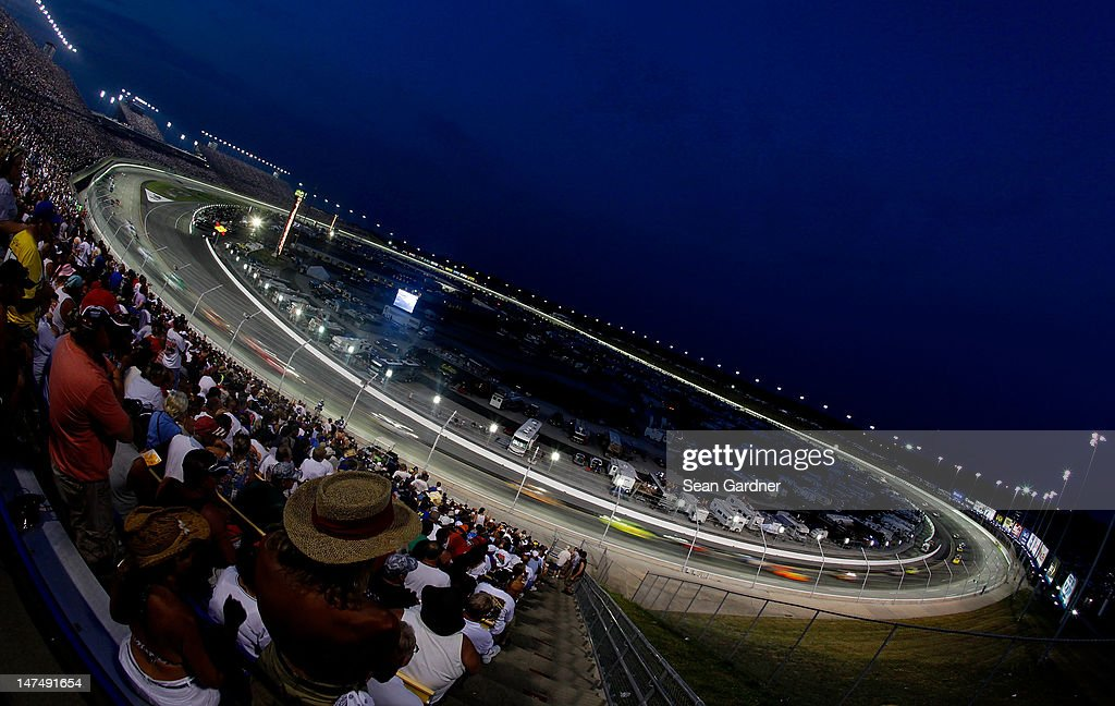 Cars race during the NASCAR Sprint Cup Series Quaker State 400 at Kentucky Speedway on June 30, 2012 in Sparta, Kentucky.