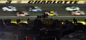 Cars race during the NASCAR Sprint Cup Series Sprint AllStar Race at Charlotte Motor Speedway on May 17 2014 in Charlotte North Carolina