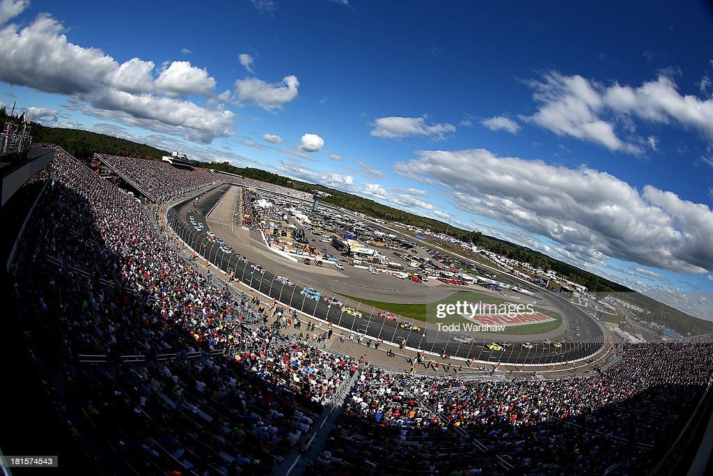 Cars race during the NASCAR Sprint Cup Series Sylvania 300 at New Hampshire Motor Speedway on September 22, 2013 in Loudon, New Hampshire.