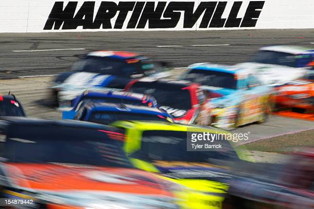 Cars race during the NASCAR Sprint Cup Series Tums Fast Relief 500 at Martinsville Speedway on October 28 2012 in Ridgeway Virginia