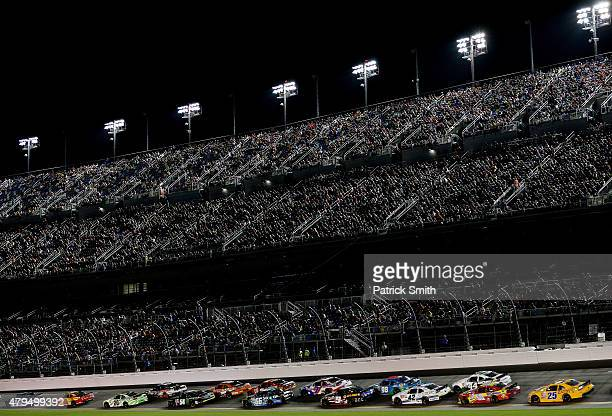 Cars race during the NASCAR XFINITY Series Subway Firecracker 250 Powered By CocaCola at Daytona International Speedway on July 4 2015 in Daytona...