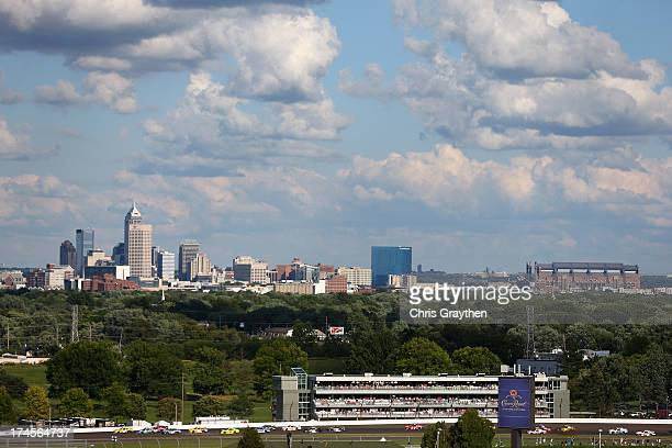 Cars race through turn two with the skyline of downtown Indianapolis during the NASCAR Nationwide Series Indiana 250 at Indianapolis Motor Speedway...