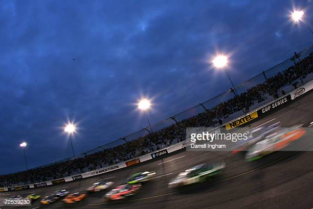 Cars race under the lights on a Friday night at the NASCAR Busch Series Funai 250 on May 13 2005 at the Richmond International Raceway in Richmond...