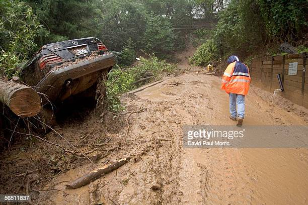 A cars rests where it slid off the road during a mudslide on Tamalpias Road January 2 2006 in Fairfax California Northern California has been...