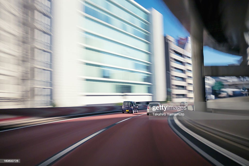 Cars Running Fast along the Expressway
