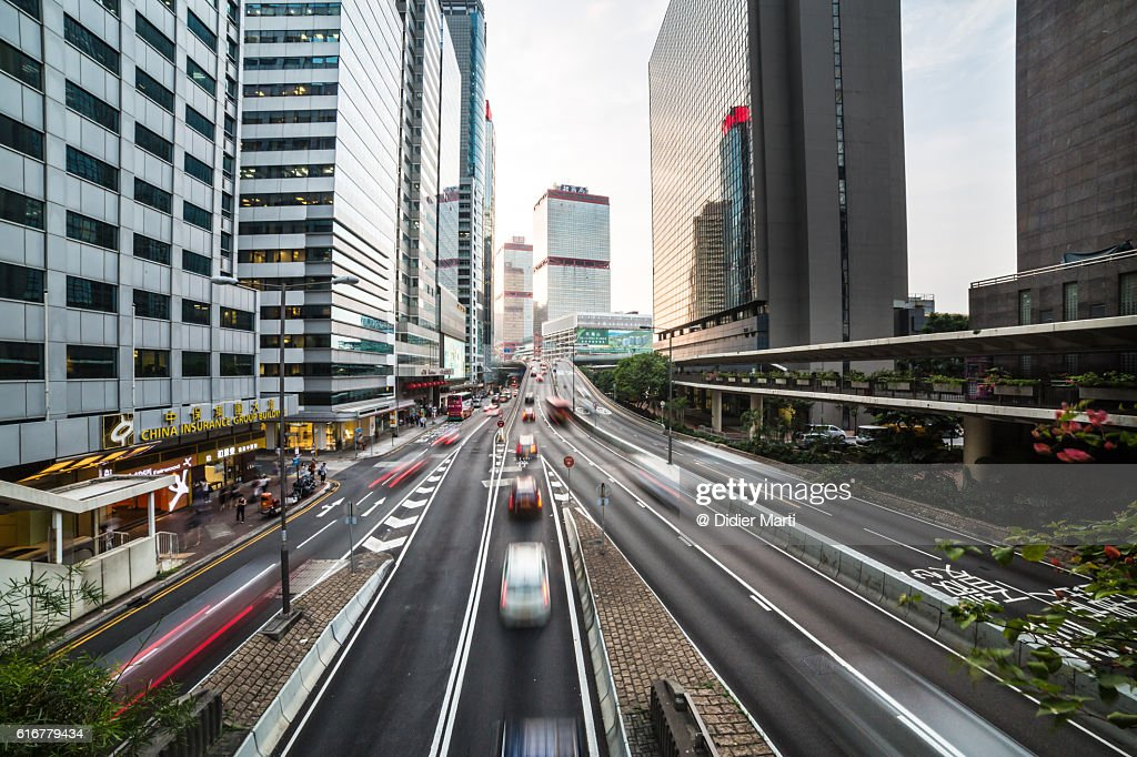 Cars rush in Hong Kong Central district : Stock Photo