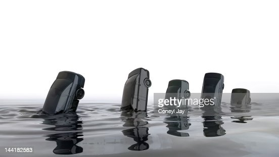 Cars sinking in ocean of crude oil : Stock Photo
