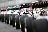 Cars sit at the end of the pitlane as the grid waits to restart the weather delayed qualifying session for the Australian Formula One Grand Prix at...