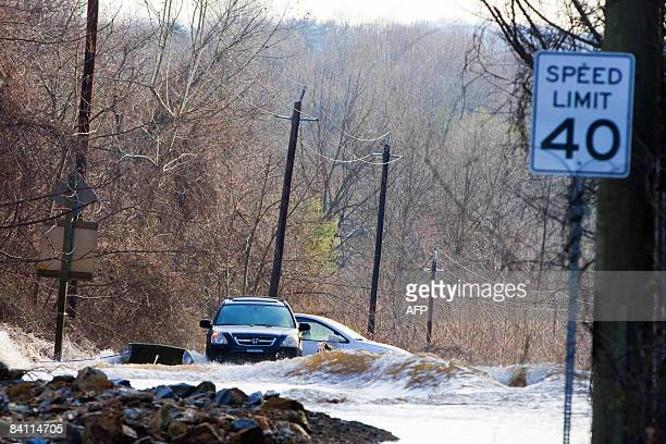 Cars sit awash in a flood on December 23 2008 caused by a water main break on River Road in Montgomery County near Bethesda A 5andhalf foot water...