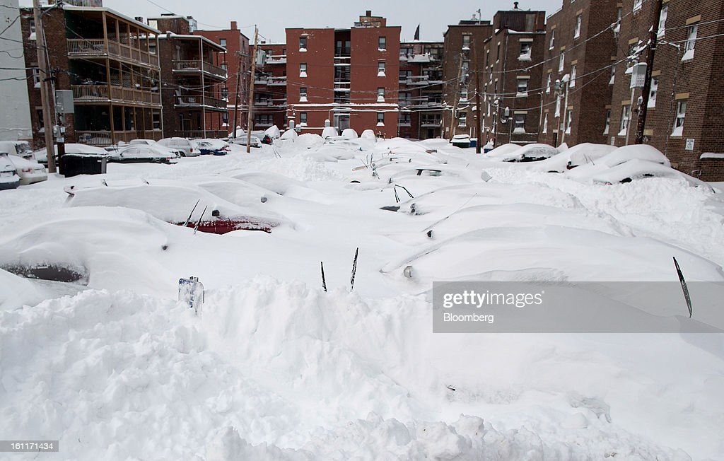 Cars sit buried under snow in a parking lot off of Brainerd Street after Winter Storm Nemo in Boston, Massachusetts, U.S., on Saturday, Feb. 9, 2013. More than two feet of snow fell on parts of the U.S. Northeast as high winds left hundreds of thousands of people in the region without power, closed highways and forced the cancellation of 4,700 flights. Photographer: Scott Eisen/Bloomberg via Getty Images