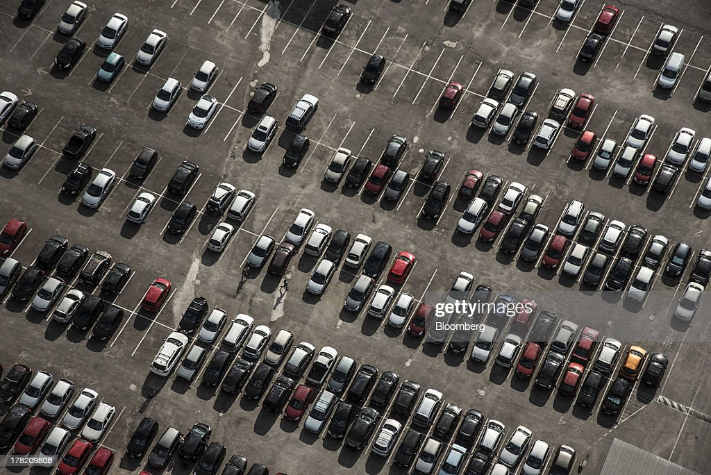 Cars sit in a parking lot in this aerial photo taken in Sao Paulo, Brazil, on Friday, Aug. 23, 2013. Home sales in Sao Paulo, Brazils biggest real-estate market, rose 46 percent in January through June from a year earlier, while housing starts climbed 51 percent, according to Embraesp, a property research group, and Secovi, a real-estate agency association. Photographer: Paulo Fridman/Bloomberg via Getty Images