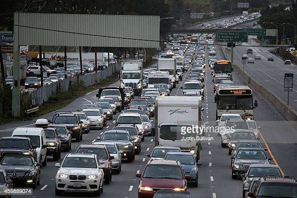 Cars sit in mileslong traffic jam on southbound highway 101 as they approach a flooded section of the freeway on December 3 2014 in Mill Valley...