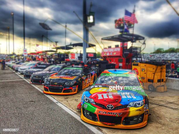 Cars sit in pit boxes prior the NASCAR Sprint Cup Series Toyota Owners 400 at Richmond International Raceway on April 26 2014 in Richmond Virginia