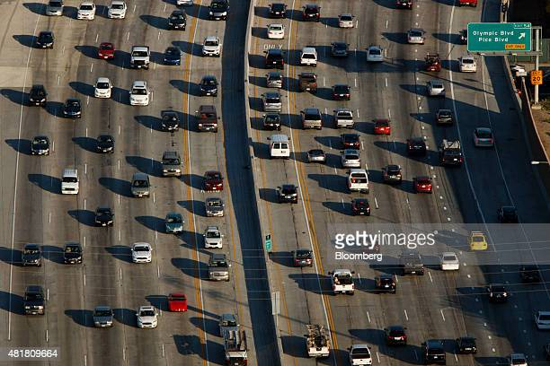 Cars sit in rush hour traffic on the 405 Freeway at Olympic Blvd in this aerial photograph taken over Los Angeles California US on Friday July 10...