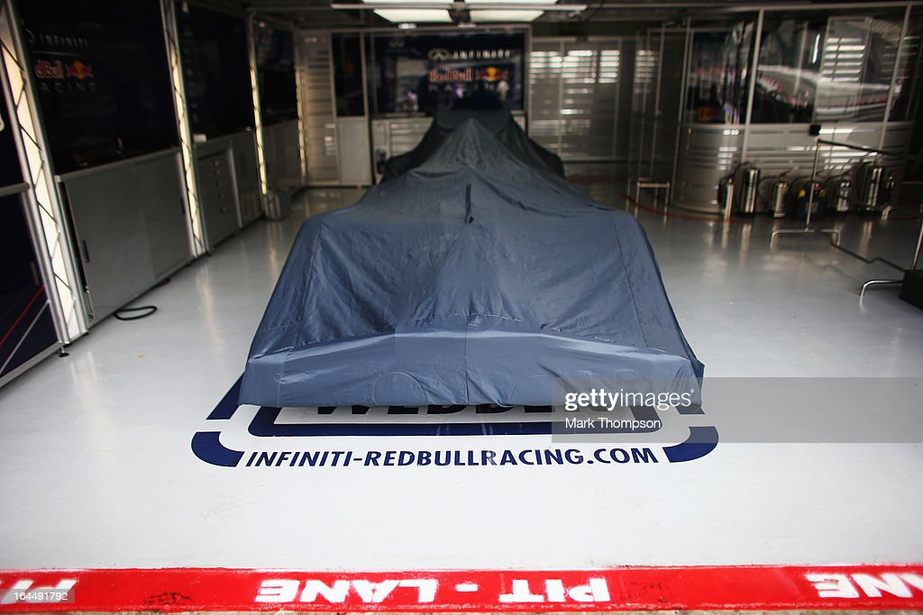 Cars sit in the Infiniti Red Bull Racing garage under parc ferme conditions before the Malaysian Formula One Grand Prix at the Sepang Circuit on March 24, 2013 in Kuala Lumpur, Malaysia.