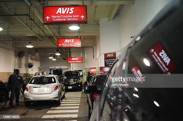 Cars sit ina lot at an Avis rental car branch in Manhattan on January 2 2013 in New York City Avis Budget Group announced January 2 that it has...