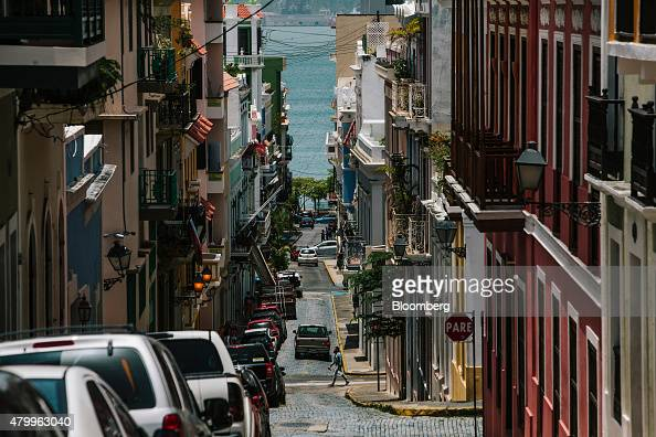 Cars sit parked along a street in the Old City of San Juan Puerto Rico on Wednesday July 8 2015 A growing number of Republicans in the US Congress...