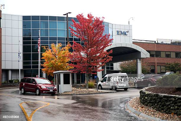 Cars sit parked outside of the EMC Corp headquarters building in Hopkinton Massachusetts US on Tuesday Oct 13 2015 Dell Inc's $67 billion buyout of...