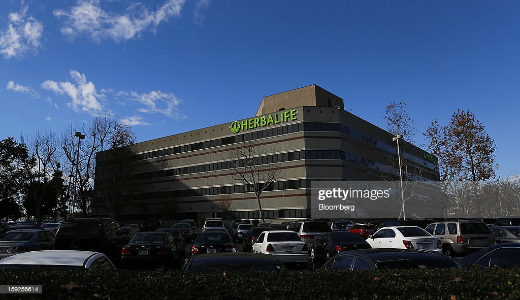 Cars sit parked outside of the Herbalife Ltd. corporate headquarters in Torrance, California, U.S., on Thursday, Jan. 10, 2013. Daniel Loeb is squaring off against Bill Ackman over the future of Herbalife Ltd. By taking an 8.2 percent stake in the direct seller of nutrition shakes, Loeb's Third Point LLC is the latest firm to reject hedge fund manager Ackman's theory that Herbalife is a pyramid scheme. Photographer: Patrick Fallon/Bloomberg via Getty Images