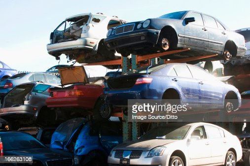 Cars sitting in junkyard