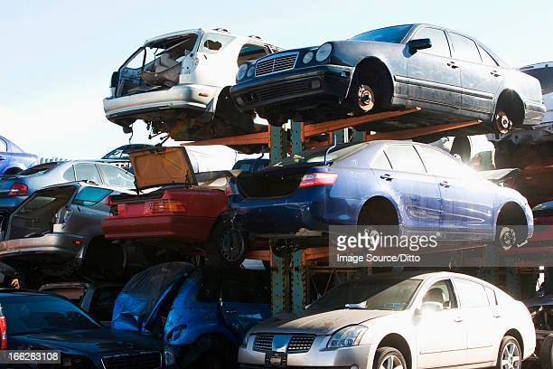 Cars sitting in junkyard