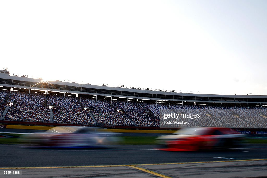 Cars speed down pit road during qualifying for the NASCAR Sprint Cup Series Coca-Cola 600 at Charlotte Motor Speedway on May 27, 2016 in Charlotte, North Carolina.