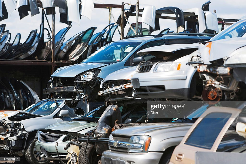 Cars stacked in scrap yard : Stock Photo