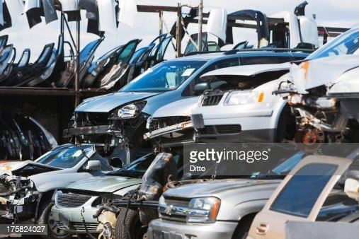 Cars stacked in scrap yard