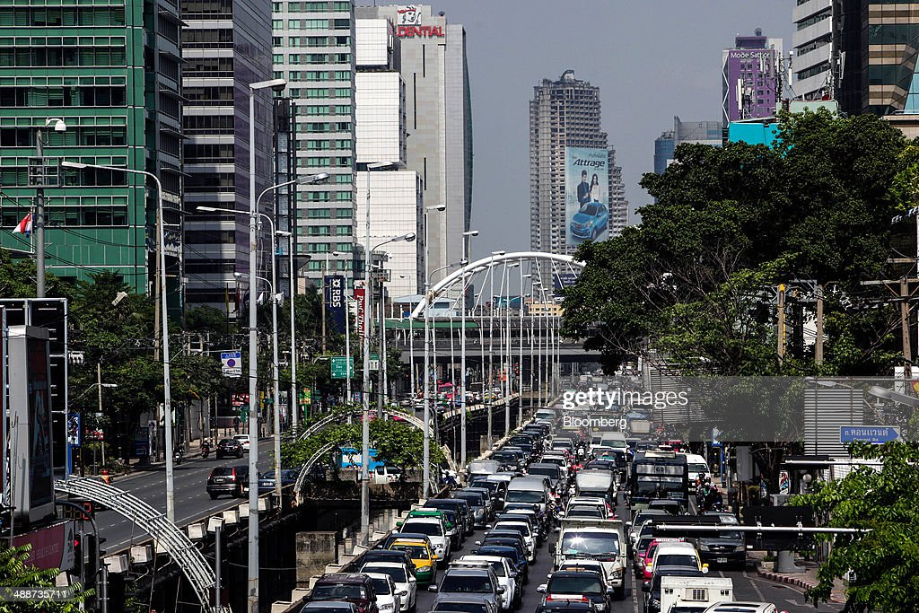 Cars stand congested along Sathorn road in the Sathorn financial district in Bangkok, Thailand, on Thursday, May 8, 2014. The baht fell to a one-month low and stocks slumped on concern global investors will shun Thailand after a court ruling to remove Yingluck Shinawatra as prime minister worsened the nation's political crisis. Photographer: Dario Pignatelli/Bloomberg via Getty Images