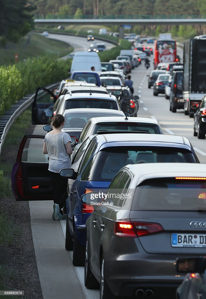 Cars stand in a traffic jam on the A13 highway towards Berlin on May 22, 2016 near Mittenwalde, Germany. Summer road repairs tend to lead to frequent traffic jams on German highways.