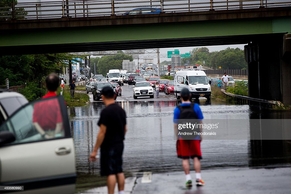 Cars stop in front of a flooded street at Sunrise Highway under the 5th Ave overpass following heavy rains and flash flooding August 13, 2014 in Bayshore, New York. The south shore of Long Island along with the tri-state region saw record setting rain that caused roads to flood entrapping some motorists.