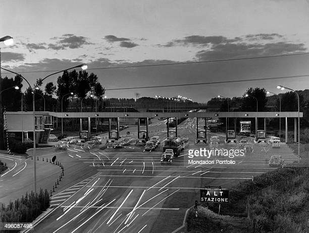 Cars stopping at the tool booth of Milan along the MilanNaples A1 motorway Italy 1970s