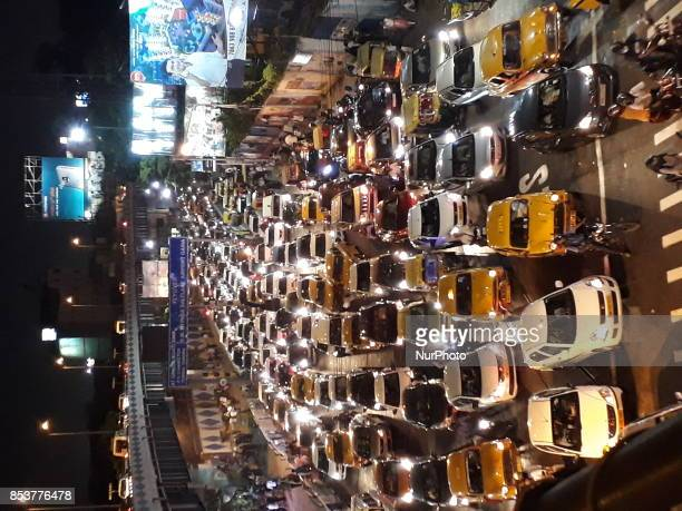 Cars stuck stand by at the Central Kolkata heavy traffic jams during the mass devotees visit the Durga puja pandal on September 252017 in KolkataIndia