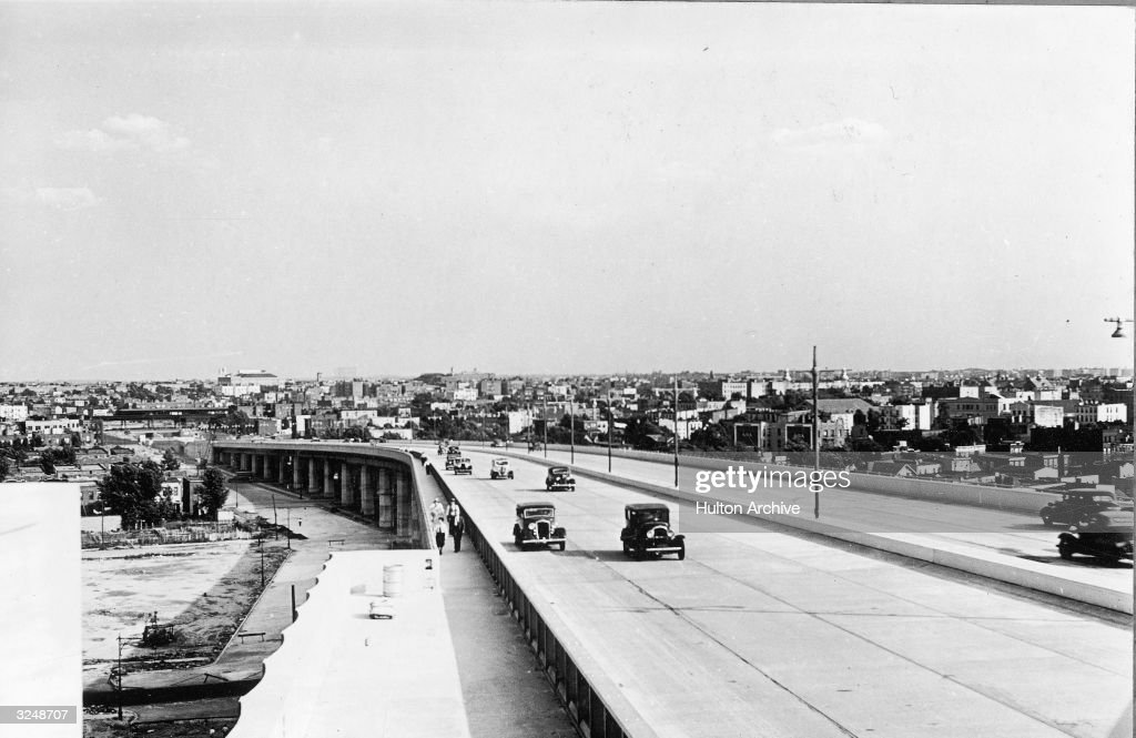 Cars travel on the Triborough Bridge ramp to Astoria Queens New York City