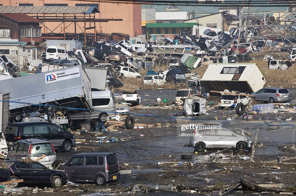 Cars trucks and other debris were swept inland by the inland by a tsunami following an earthquake in Sendai city Miyagi prefecture Japan on Sunday...