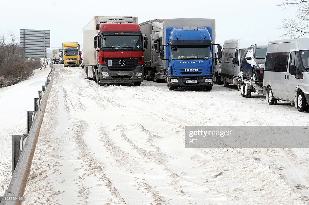 Cars, vans and trucks are stuck in a traffic jam on the E75 motorway, nearby Gyor on March 15, 2013 a day after a heavy snow storm hit the area. A cold snap, that caused havoc elsewhere in Europe, sent temperatures plunging and blanketed large parts of Hungary in snow, causing major transport problems and leaving tens of thousands without electricity.