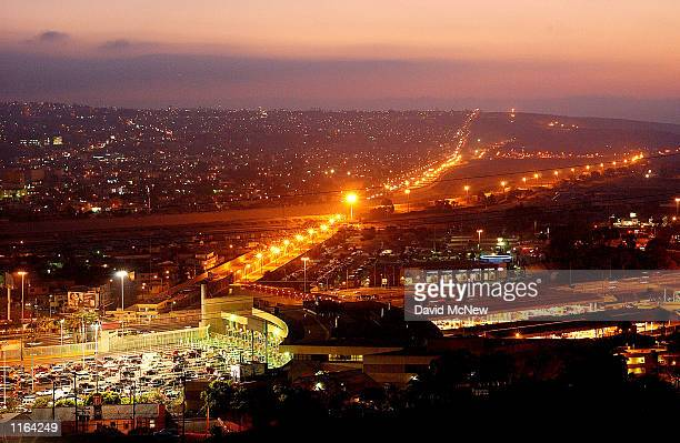Cars wait for hours to enter the US from Mexico at the San Ysidro border crossing September 19 2001 in San Ysidro CA Beefed up security has increased...