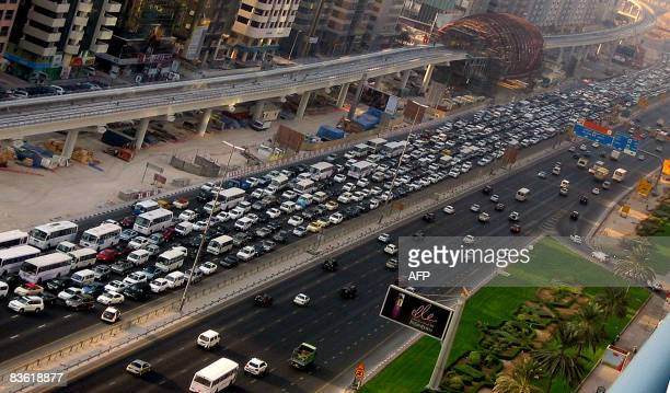 Cars wait in a bottleneck jam on Dubai's Sheihk Zayed road which was blocked by a damaged crane on November 9 2008 The crane which was used for the...