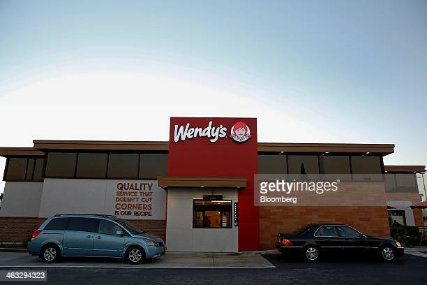 Cars wait in line at the drivethru at a Wendy's Co restaurant in Torrance California US on Thursday Jan 16 2014 Wendys saw a 57% premarket gain...