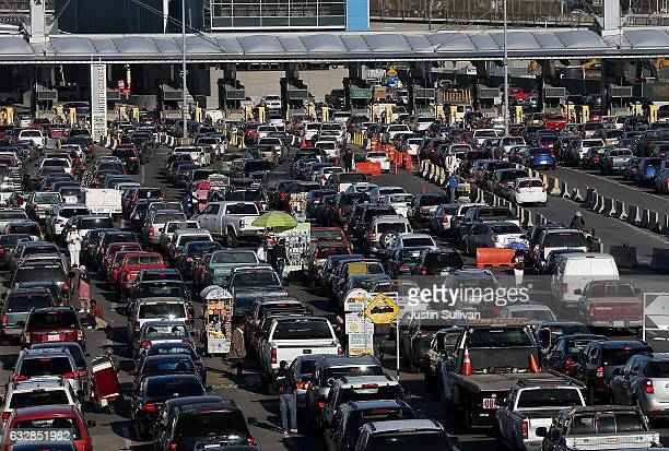 Cars wait in line to enter the United States at the San Ysidro Port of Entry on January 27 2017 in Tijuana Mexico US President Donald Trump announced...
