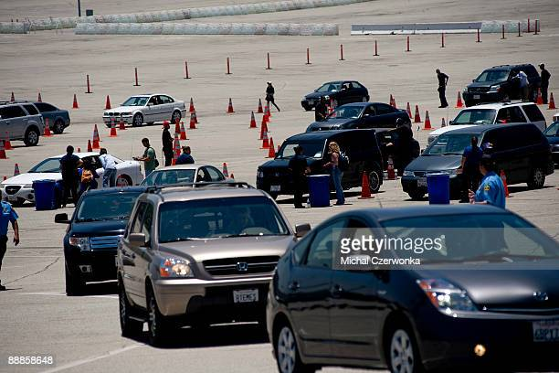 Cars wait on line to receive wristbands and tickets at the Michael Jackson Memorial Service ticket pickup area held at a parking lot at Dodger...